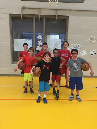 Image of kids participating in a GTA Training after school basketball program